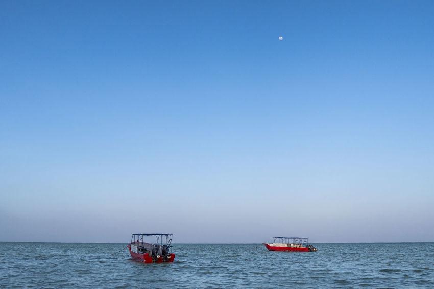 Boats on water Transportation Water Sky Sea Nautical Vessel Horizon Over Water Blue Moon Tranquility Sailboat Travel No People Horizon Ocean Zanzibar Boat Ship Sail