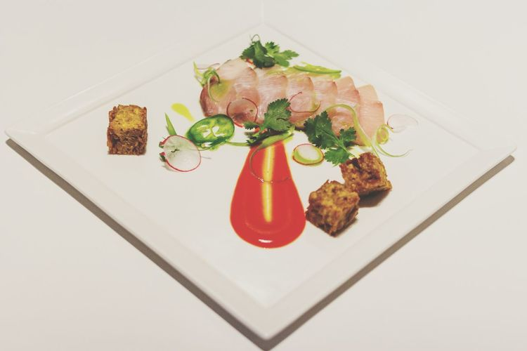 Meat And Coriander Leaves With Sauce On Plate