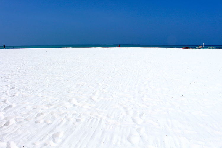 white Zanzibar beach Sky Clear Sky Land Tranquility Day Sea Water Nature Tranquil Scene Scenics - Nature Blue Beauty In Nature Beach Sand No People White Color Copy Space Horizon Outdoors Horizon Over Water Salt Flat