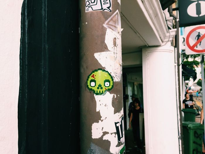 Skull Label On Column In City