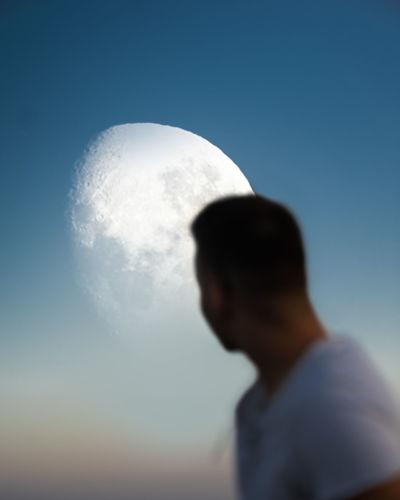 Portrait of man against blue sky
