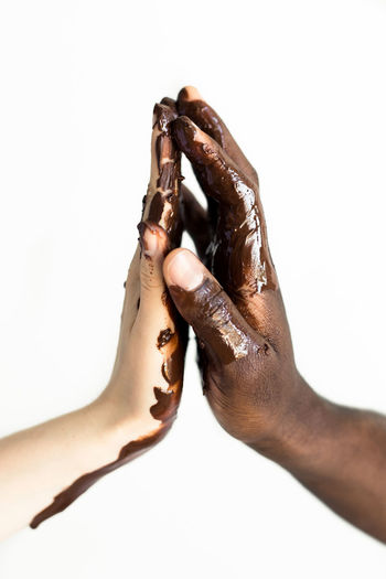 Sweet to the touch Chocolate Close-up Couple Couple - Relationship Friends Friendship Holding Human Human Body Part Human Finger Human Hand Indoors  Interracial Love Melting People Personal Perspective Relationship Studio Shot SUPPORT Touching White Background EyeEmNewHere