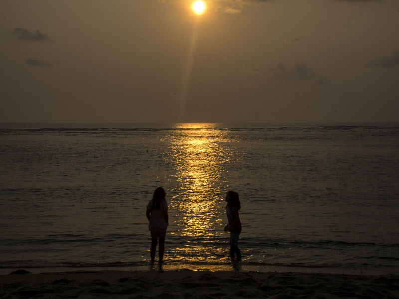 sihouette of two girls during sunrise Beach Beauty In Nature Chidren Horizon Over Water Nature Outdoors People Scenics Sea Silhouette Sisters Sky Sun Sunset Two People Water