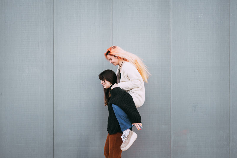 Women Young Adult Adult Two People Side View Standing Togetherness Young Women Indoors  People Casual Clothing Females Architecture Emotion Wall - Building Feature Full Length Copy Space Positive Emotion Couple - Relationship Hairstyle