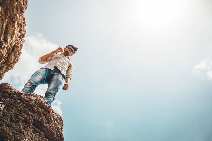 Men Fashion Copy Space Sky Hiker Rock Climbing Free Climbing Rock Face Extreme Sports Mountain Climbing Climbing Safety Harness Clambering
