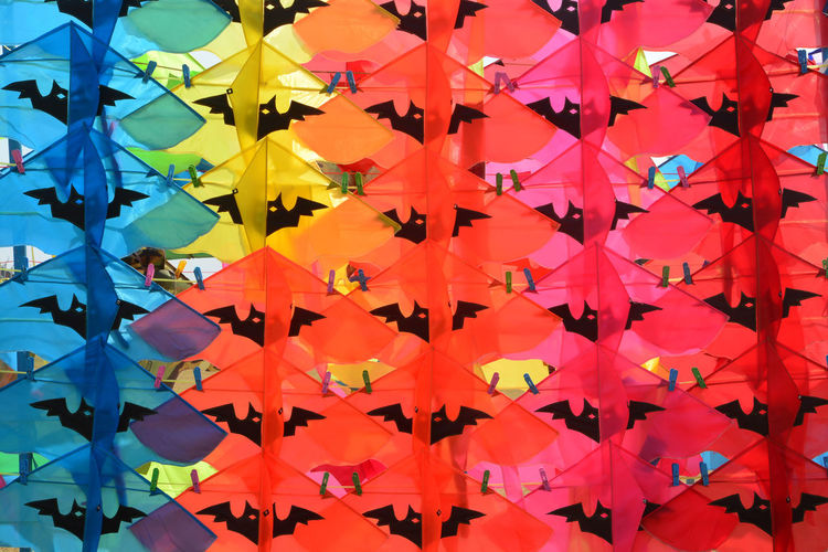Full frame shot of multi colored umbrellas hanging on wall