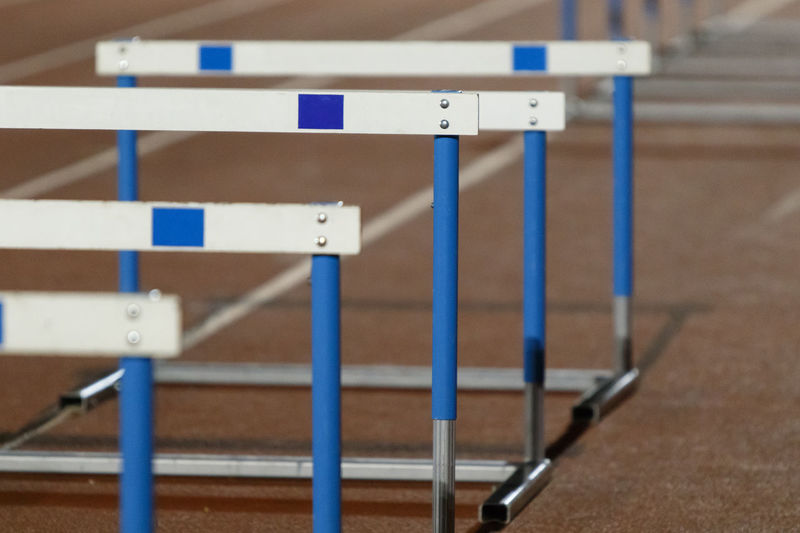Rows of hurdles. Athlete Athletics Educating Hurdles Lifestyle Running Stadium Atheltics Athletics Track Backgrounds Barrier Competitive Sport Energy Fence Fitness Healthy Healthy Eating Heatlhy No People Obstacle Outdoors Race Runner Sport Training