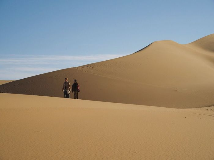Jaran Sand Dune Sand Desert Arid Climate Nature Extreme Terrain Landscape Scenics Real People Togetherness Outdoors Tranquility Two People Sky Day Lifestyles Beauty In Nature Clear Sky Men Mammal Lost In The Landscape Lost In The Landscape Lost In The Landscape Connected By Travel