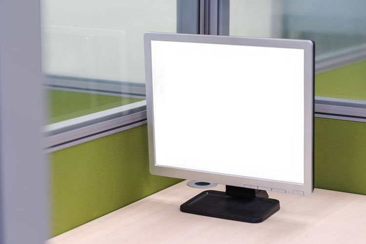 Close-Up Of Blank Computer Monitor On Desk At Office