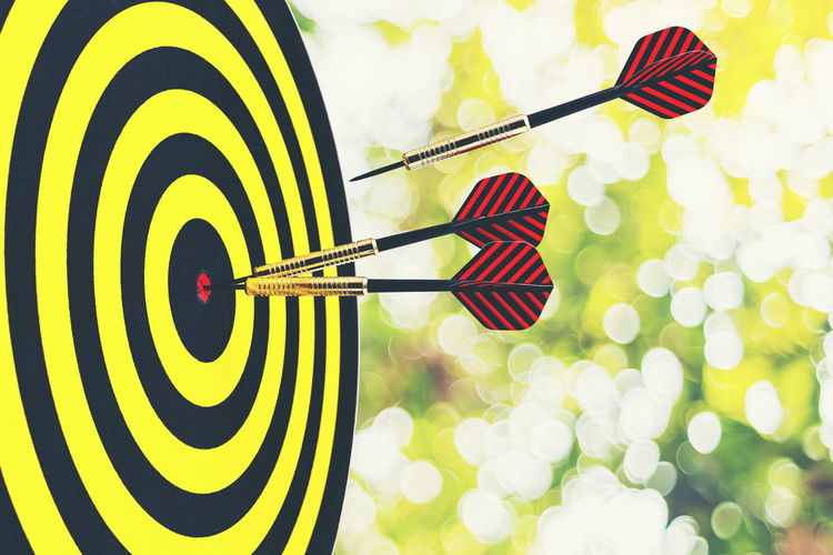 Target dart with Arrows Business Accuracy Arrow - Bow And Arrow Circle Close-up Concept Day Flag Focus On Foreground Idea Indoors  Leisure Activity Marketing No People Number Pattern Shape Sport Sports Target Striped Success Yellow