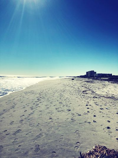 Perspective Beach Sand Nature Sea Tranquility Blue Beauty In Nature Sunlight Scenics Outdoors Tranquil Scene No People Sky Clear Sky Day Water Landscape