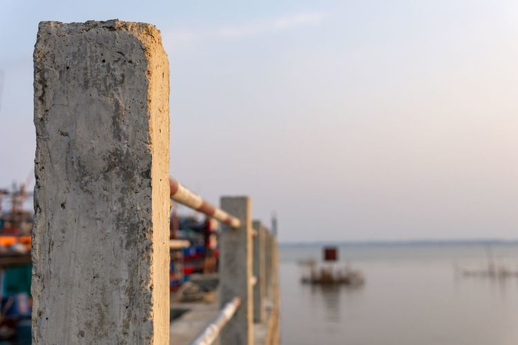 Cement pole in port. Clear Sky Rural Vietnam Architecture Bay Built Structure Cement Pole Cement Post Close-up Copy Space Countryside Day Estuary Fence Focus On Foreground Nature No People Outdoors Pole Post Sky Tranquil Scene Tranquility Water Waterfront