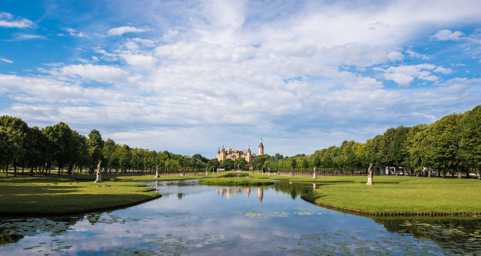 Schwerin castle and lake against cloudy sky
