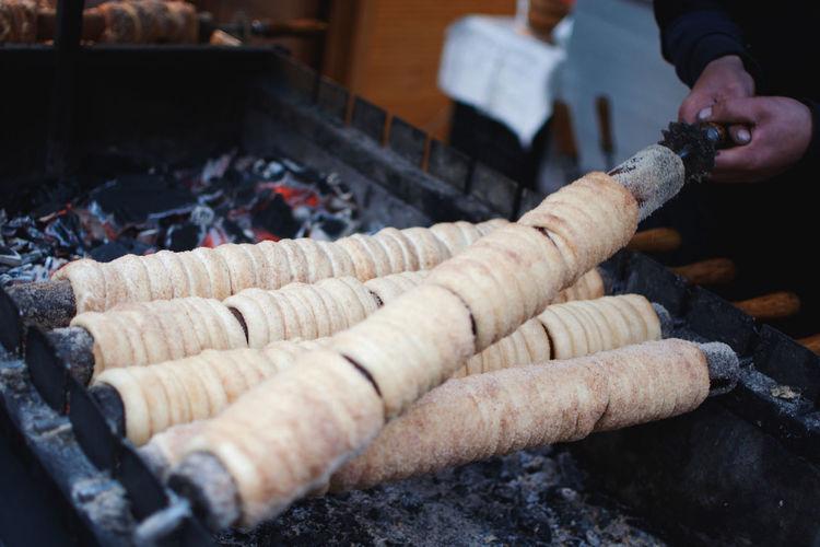 Cropped hands of man preparing food