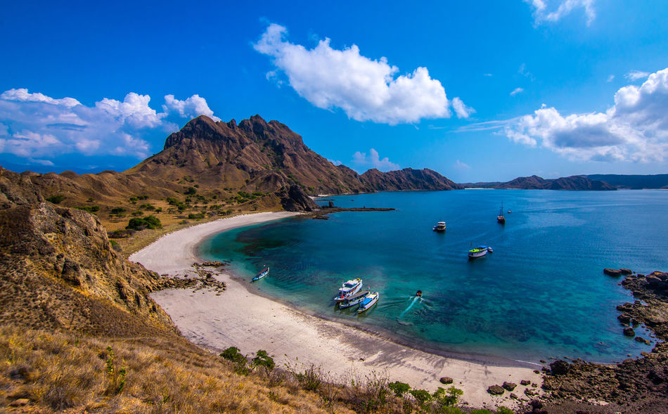 Padar Island near Komodo & Rinca Islands Indonesia Beach Beachphotography Beauty In Nature Blue Boats Cloud - Sky Day INDONESIA Island Komodo Mountain Mountain Range Nature Nautical Vessel No People Outdoors Padar Padar Island Paradise Rinca Scenics Sea Sky Tropical Water The Traveler - 2018 EyeEm Awards