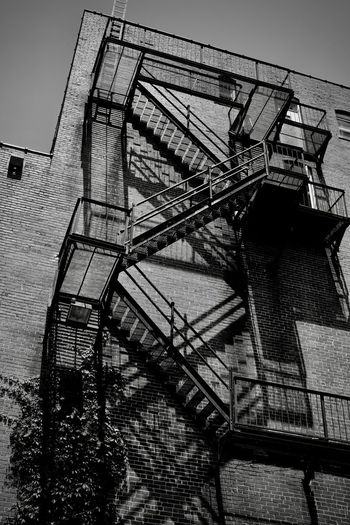 Escape Architecture Building Exterior Built Structure Day Fire Escape Low Angle View No People Outdoors Railing Sky Staircase Steps Steps And Staircases Streetphotography