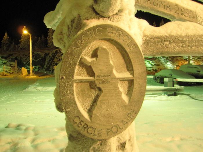 Close-up of snow on illuminated city street during winter