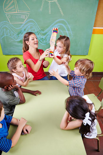 High angle view of people with kids in classroom