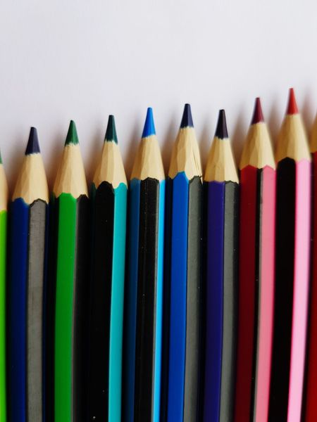 EyeEm Selects Education Pencil Colored Pencil Multi Colored Art And Craft Student In A Row Crayon Variation Choice Learning Close-up Wood - Material Large Group Of Objects Yellow Indoors  Pencil Drawing White Background Pencil Shavings Day