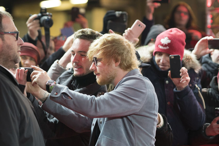 Berlin, Germany - February 23, 2018: Ed Sheeran poses for a selfie with a fan while attending the 'Songwriter' premiere during the 68th Berlinale International Film Festival Berlin 2018 Artist Celebrity Ed Sheeran Ed Sheeran <3 Ed Sheraan❤ Famous Singer  Singer/Song Writer Arts Culture And Entertainment Berlinale Berlinale 2018 Berlinale Festival Berlinale2018 Berlinale68 Celebrities Crowd Event Famous People Fans Focus On Foreground Group Of People People Real People Singer And Artist Song Writer