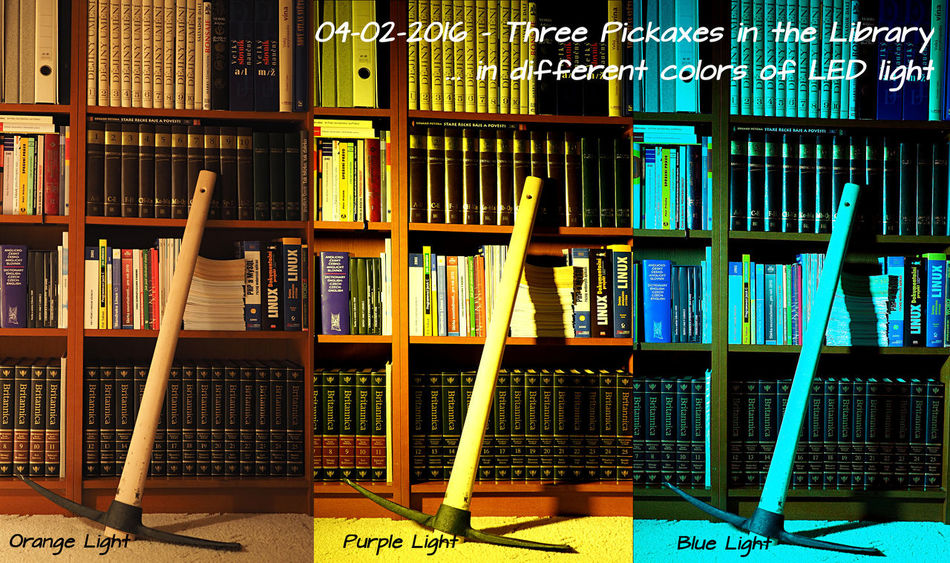 Three Pickaxes in the Library ... in different colors of LED light --- Arrangement Book Collection Different Colors Indoors  Led Lights  Library Pickaxe Shelf Three