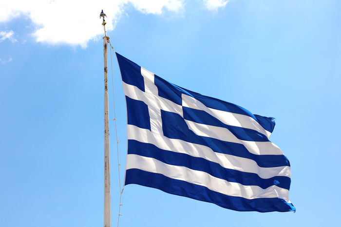 Greek Greek Flags Blue Blue Sky Cloud - Sky Day Environment Flag Greek Flag Greek Flag On The Ship Independence Low Angle View National Icon Nature No People Outdoors Patriotism Pole Shape Sky Star Shape Striped Waving White Color Wind