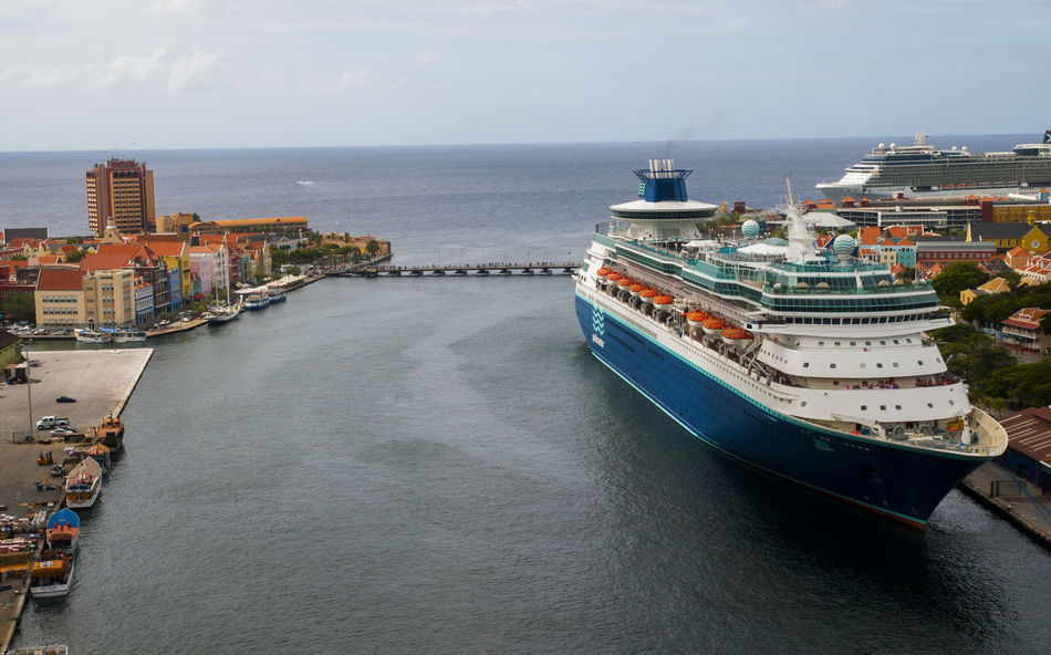 Curaçao is an island country in the southern Caribbean Sea, approximately north of the Venezuelan coast, that is a constituent country of the Kingdom of the Netherlands. Beauty In Nature Boat Cruiseship Downtown Harbour Horizon Over Water Mode Of Transport Nature Nautical Vessel No People Outdoors Scenics Sea Shore Sky The Way Forward Tranquil Scene Tranquility Transportation Water Waterfront Willemstad