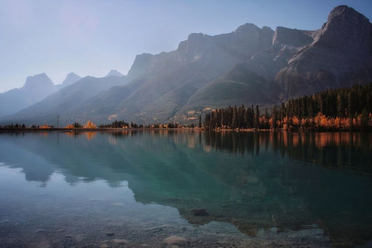 Scenic view of mountains reflected in lake during autumn