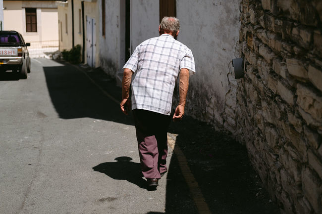 Rear View Real People Walking One Person Lifestyles City Casual Clothing Senior Adult Shadow Day Men Sunlight Walking Cane Adult Plaid Light And Shadow Streetphotography