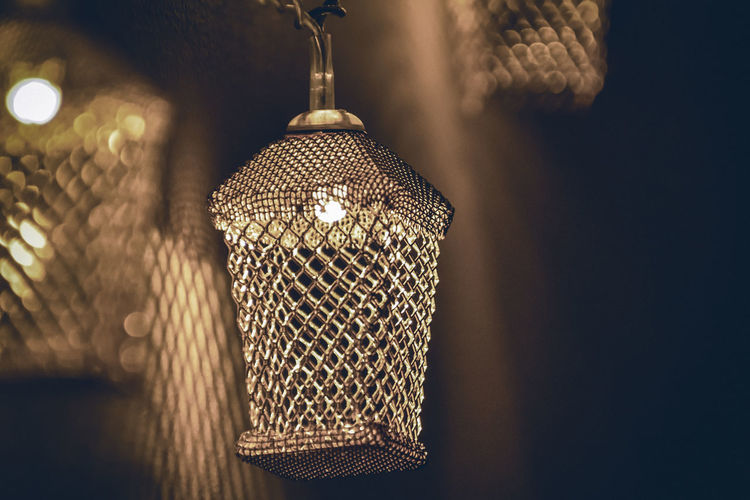 Close-up of illuminated lamp hanging on table