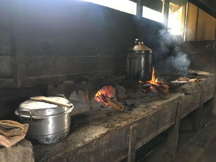 Food getting prepared on wood burning stove