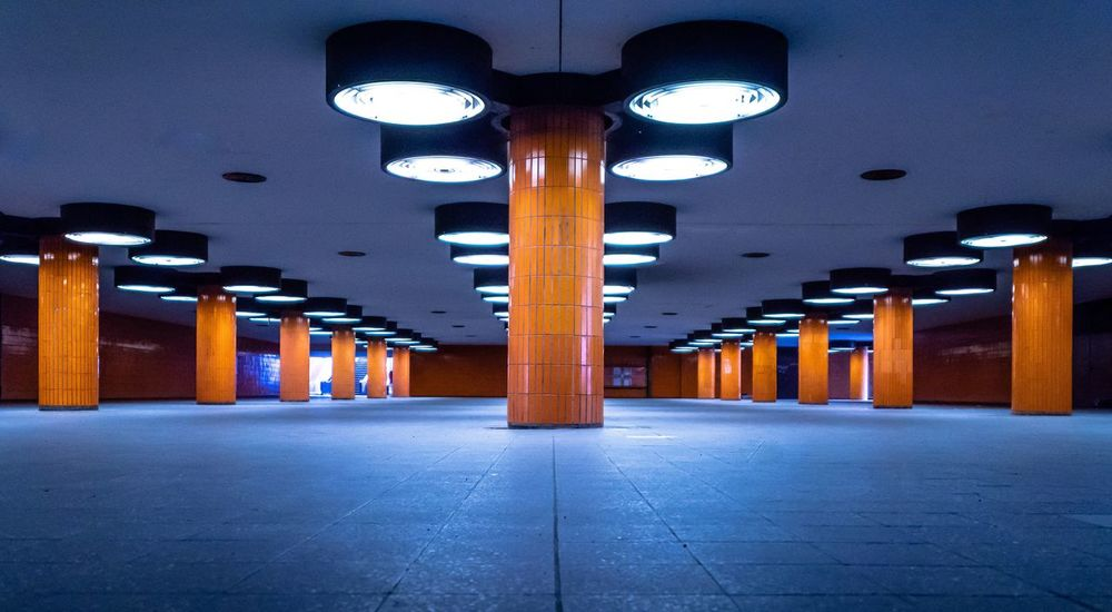 Symmetry Futuristic Orange Color Pillars Charlottenburg  Messedamm Underpass Tunnel Illuminated Architectural Column Lighting Equipment Architecture Transportation Built Structure Ceiling Subway No People Public Transportation The Way Forward Light Parking Lot Electric Light In A Row Indoors  Direction Empty