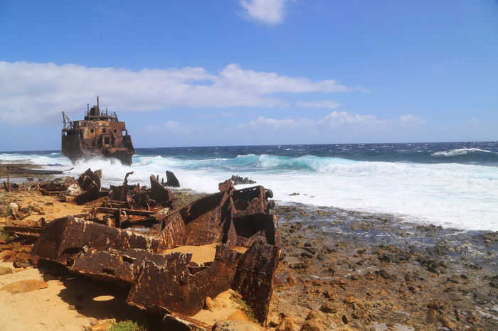Beach Blue Cloud Cloud - Sky Coastline Horizon Over Water Klein Curacao Metal Monster Outdoors Rust Never Sleeps Rustographer Scenics Sea Ship Shipwreck Shore Sky Stranded Water Wave Wrecked