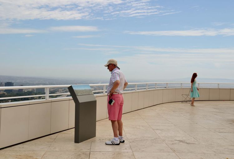 People standing at observation point against sky