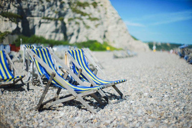 Travel Absence Beach Beauty In Nature Chair Cliff Close-up Day Deckchair England Focus On Foreground Folding Chair Nature No People Outdoors Relaxation Sand Sea Sky Summer Sunlight Tranquil Scene Tranquility Vacations Water