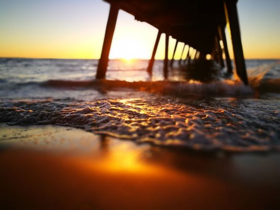 Sunset to here Sunlight Sunset Nature Sea Water No People Surface Level Beauty In Nature Outdoors Beach Sunbeam Close-up Sky Day