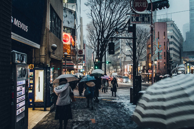 Cityscape Japan Japan Lovers Shibuyascapes Tokyo Urban Exploration Winter Adult Architecture Building Building Exterior Built Structure City City Life City Street Cold Dusk Group Of People Human Vs Nature Mode Of Transportation Outdoors People Rain Real People Road Snow Snow Covered Snow Day Snowing Snowy Street Transportation Umbrellas Urban Urban Landscape Walking Wet Women The Great Outdoors - 2018 EyeEm Awards The Street Photographer - 2018 EyeEm Awards