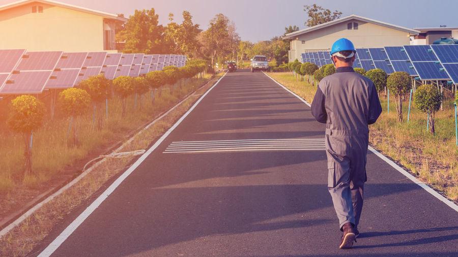 Male engineer walking on road in city