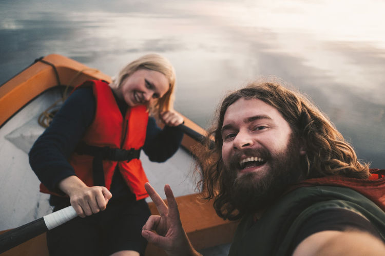 Portrait of smiling young couple in water