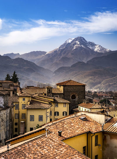 Town by mountain against sky