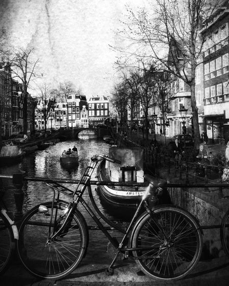 Bicycles in city against sky