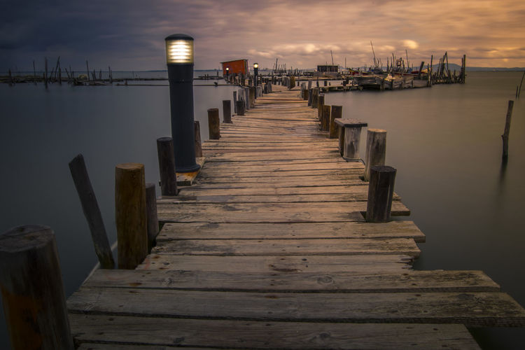 Architecture Built Structure Direction Jetty Long Nature Nautical Vessel No People Outdoors Pier Post Scenics - Nature Sea Sky The Way Forward Tranquil Scene Tranquility Transportation Water Wood Wood - Material Wood Paneling Wooden Post