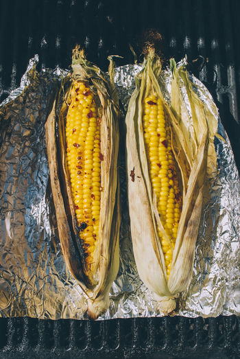 High Angle View Of Corns On Foil Paper