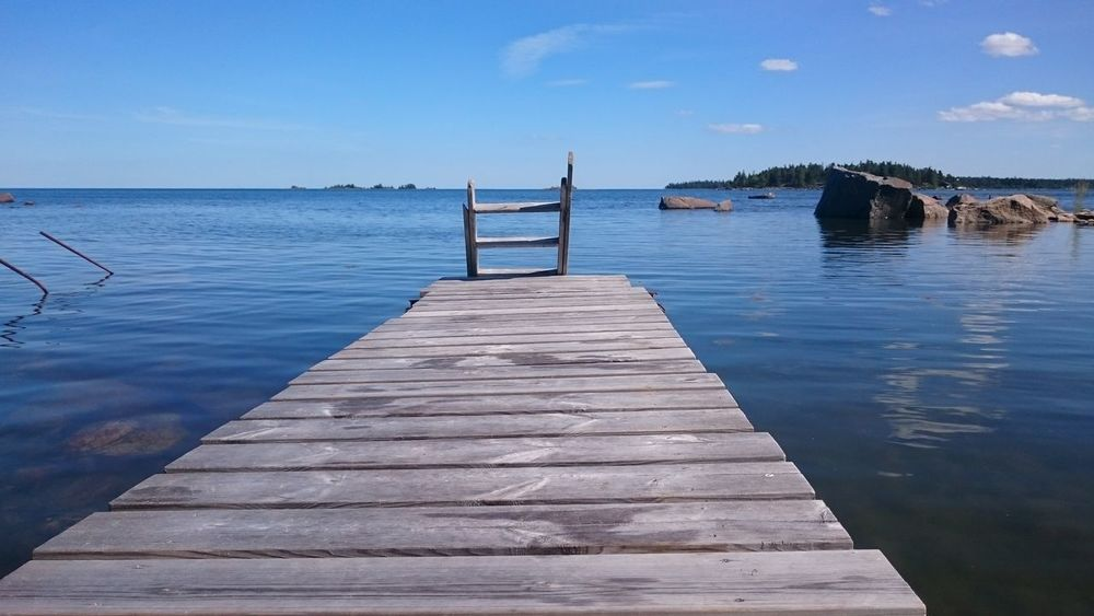 Pier Water Jetty Wood - Material Tranquility Outdoors Sea Day Tranquil Scene No People Sky Landscape Blue Scenics Travel Destinations Beauty In Nature Nature Time For Nature Swimming Time Quiet Moments