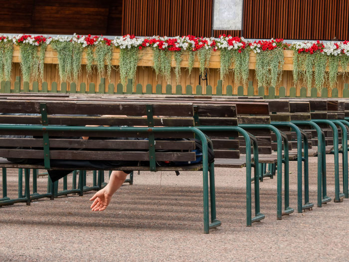 Cropped image of man relaxing on bench