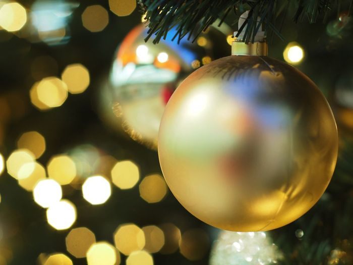 Christmas Christmas Decoration Holiday Celebration Christmas Ornament Sphere Decoration Hanging christmas tree Illuminated Tree Shiny Close-up Ball No People Event Night Reflection Gold Colored Silver Colored