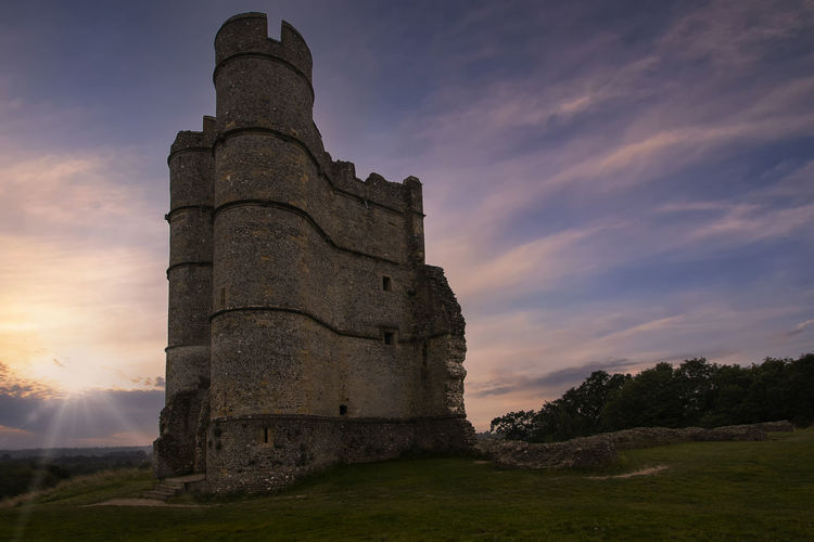 Low angle view of castle against sky during sunset
