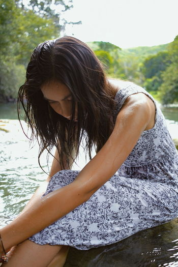 Woman sitting in river