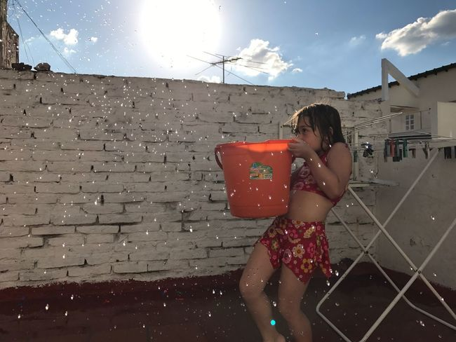 Playing With Water Summertime Real People People Day One Person Playing One Girl Only Outdoors Childhood Taking A Bath