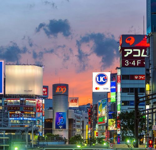 Shibuya Tokyo Tokyo Street Photography Tokyo,Japan Advertisement Architecture Billboard Building Exterior Built Structure City City Life Cloud - Sky Communication Dusk Illuminated Modern Motion Nature Night No People Outdoors Sign Sky Street Transportation